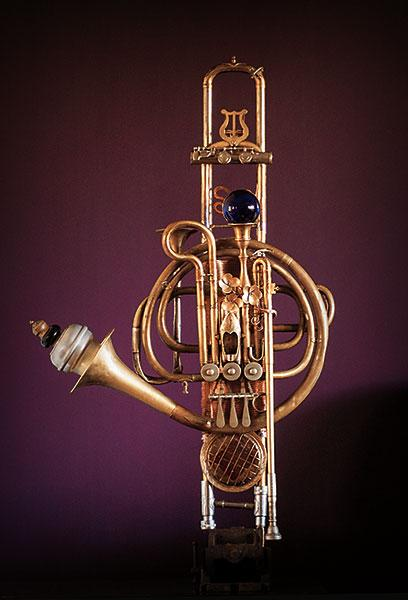 Wall sculpture made from a trombone slide.