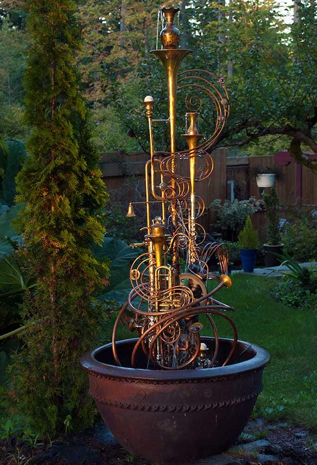 Musical Instrument fountain made from upcycled items including copper tube, a water wheel, a sax, a trumpet, a flute and an assortment of copper and brass collectable.  It comes complete with pump. This fountain is currently available for purchase @ $ 2,400. Please call or email for further info and shipping details.