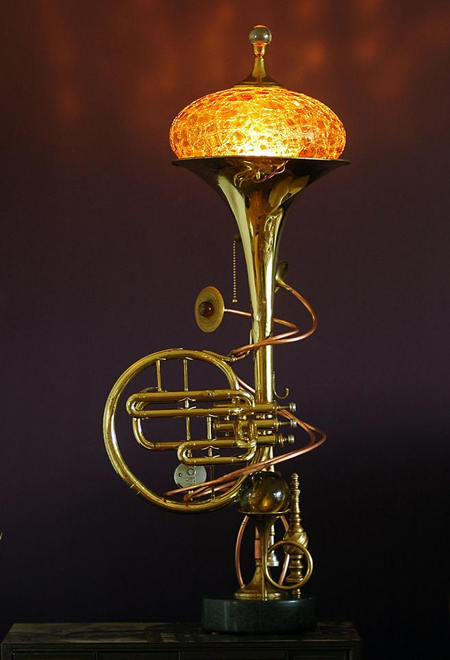 Lamp made from upcycled brass musical instrument, marble and glass.